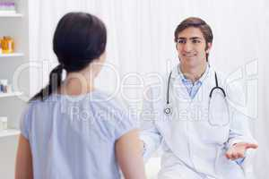 Physician having a conversation with patient