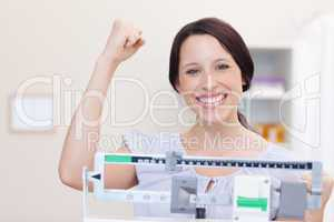 Young woman happy about what the scale shows