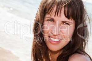 Smiling woman on sea beach