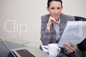 Businesswoman reading company's notification