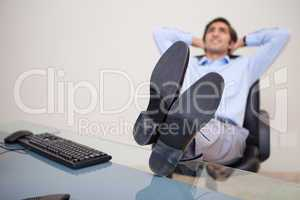 Businessman leaning back taking a moment off