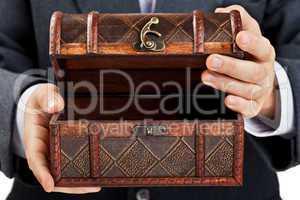 Hand holding treasure chest