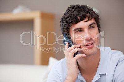 Man on the cellphone sitting in the living room