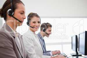 Side view of telephone service office employees