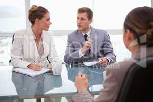 Business team deliberating with lawyer