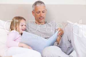 Father reading a story to his daughter