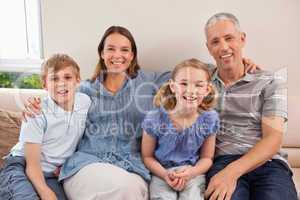 Family sitting on a sofa