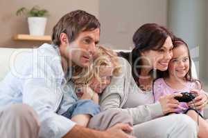 Playful family playing video games together