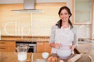 Smiling woman baking