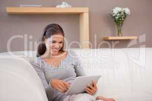 Woman with tablet pc on the sofa