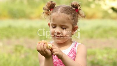 young girl holding little chicken