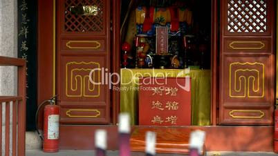 Taoist statues Buddha in door,Burning incense in Incense burner,Wind of smoke.
