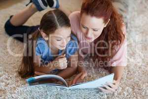 Mother and daughter on the carpet reading