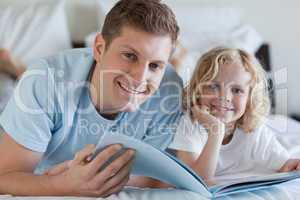 Father and son looking at magazine