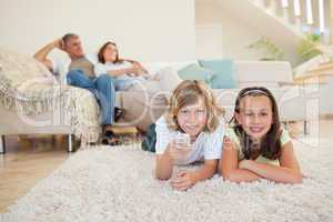 Siblings on the floor watching tv together