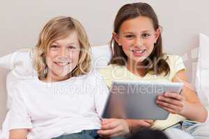 Brother and sister using tablet
