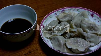 use chopsticks eating dumplings,tradition chinese new year delicious food.