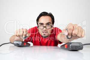 Game nerd playing with two joysticks