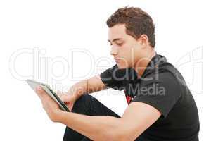 School boy with electronic tablet sitting in the floor