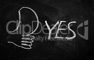 YES written on blackboard