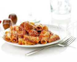 Rigatoni with tomato sauce and meatballs.
