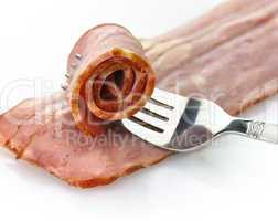 turkey bacon with fork