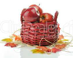 Red apples in wood basket