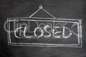 Closed - word written on blackboard