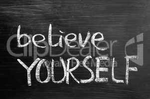 Believe yourself text written on blackboard