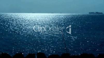 Sparkling water surface and fishing rod,horizon,skyline,Vessel Ship,night.