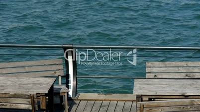 Pier,Terminals and water surface,Tables,chairs,bar,boardwalk,Dam,floating,rust.