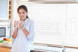 Serene woman holding a cup of tea