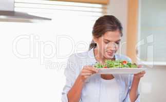 Woman smelling a salad