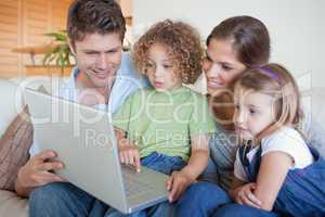 Serene family using a laptop