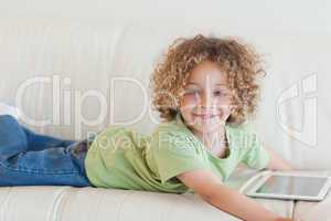 Smiling boy using a tablet computer