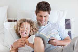 Father reading bedtime story for child