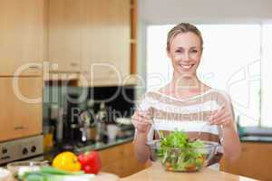 Woman preparing healthy salad