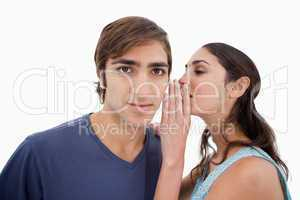 Woman whispering something to her boyfriend
