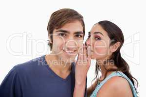 Young woman whispering something to her fiance