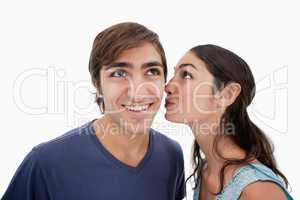 Lovely woman whispering something to her fiance
