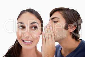 Man whispering something to his fiance
