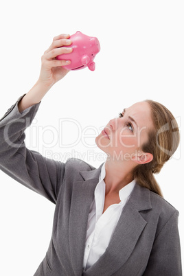 Bank employee looking at piggy bank