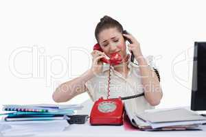 Overburden businesswoman answering the phones
