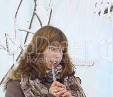 The beautiful girl with an ice icicle