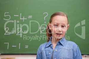 Smiling schoolgirl posing