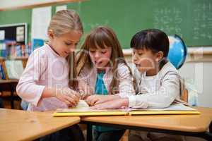 Little schoolgirls reading a fairy tale