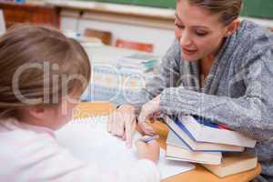 Teacher explaining something to her pupil