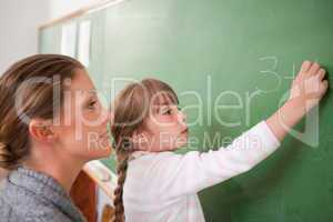 Teacher and a pupil making an addition