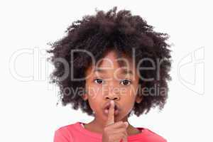 Close up of a girl asking silence