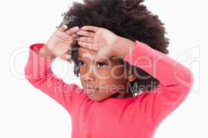 Girl with her hands on her forehead